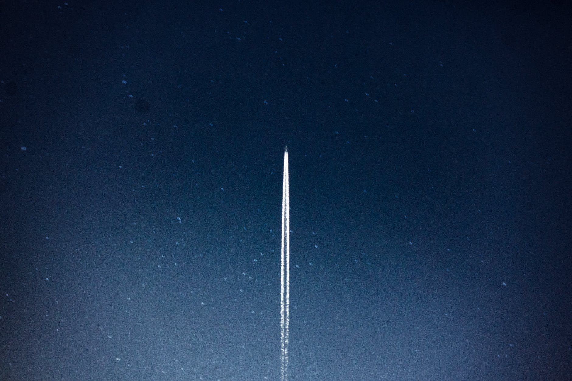 space shuttle launch during nighttime
